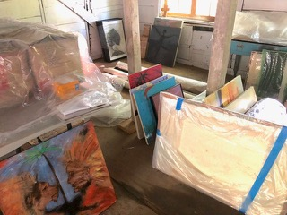 Paintings and photographs preparing to move